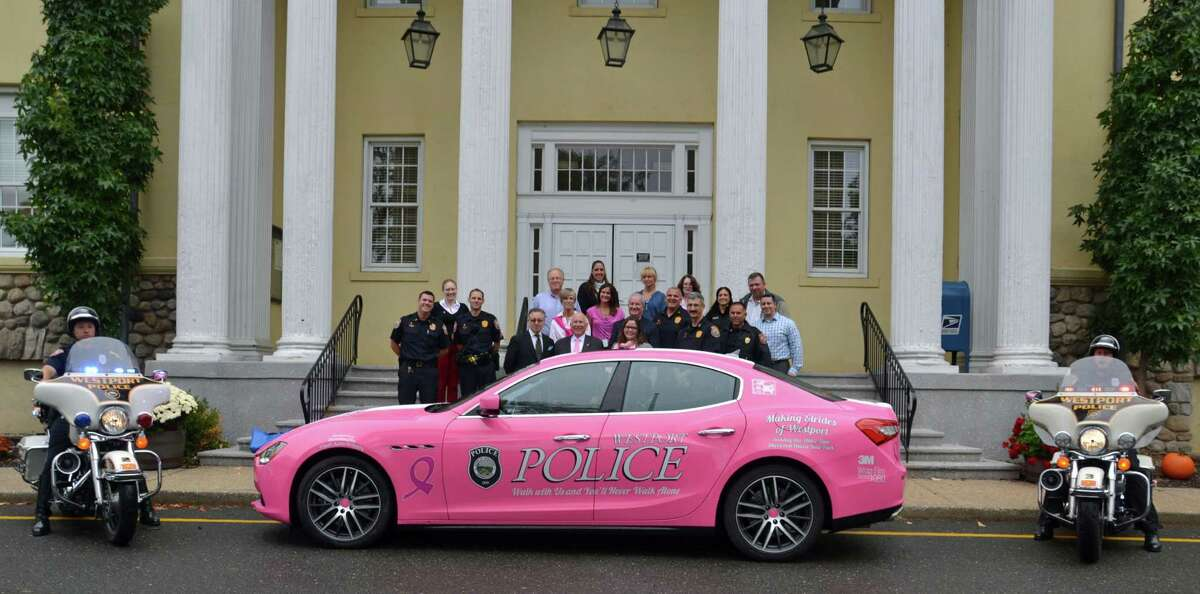 Westport's new pink police cruiser to help raise awareness of breast cancer in front of Westport Town Hall in Westport, Conn. recently.
