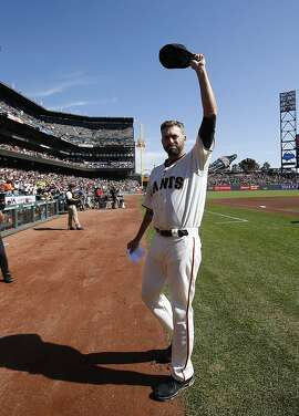 San Francisco Giants pitcher Jeremy Affeldt waves during a ceremony commemorating his career before a baseball game between the Giants and the Colorado Rockies, Sunday, Oct. 4, 2015, in San Francisco. (AP Photo/Tony Avelar)