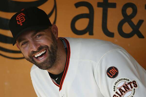 San Francisco Giants pitcher Jeremy Affeldt smiles during a ceremony commemorating his career before a baseball game between the San Francisco Giants and the Colorado Rockies, Sunday, Oct. 4, 2015, in San Francisco. (AP Photo/Tony Avelar)