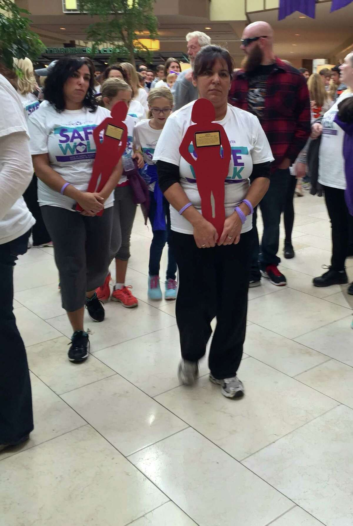 Participants in Sunday's Safe Walk carry
