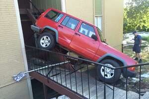 Austin Dog rescued from third floor after SUV drives up apartment complex stairs - Photo