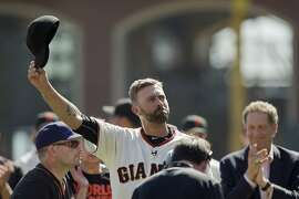 Giants pitcher Jeremy Affeldt tips his cap to the crowd during his retirement ceremony before a game at AT&T Park on Oct. 4.