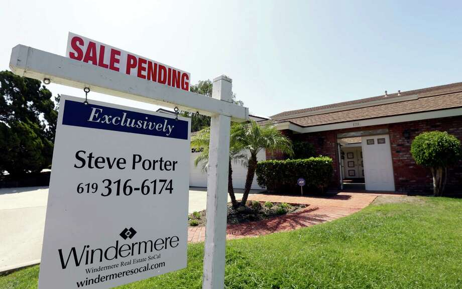 Mortgage applications submitted as of last Friday are governed by the old rules, while applications submitted on or after Saturday will fall under the new rules. Photo: Associated Press File Photo / AP