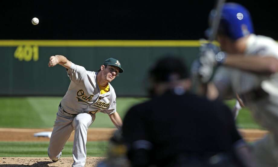 Oakland Athletics starting pitcher Chris Bassitt throws against the Seattle Mariners' Seth Smith in the second inning of a baseball game Sunday, Oct. 4, 2015, in Seattle. (AP Photo/Elaine Thompson) Photo: Elaine Thompson, Associated Press