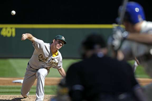 Oakland Athletics starting pitcher Chris Bassitt throws against the Seattle Mariners' Seth Smith in the second inning of a baseball game Sunday, Oct. 4, 2015, in Seattle. (AP Photo/Elaine Thompson)