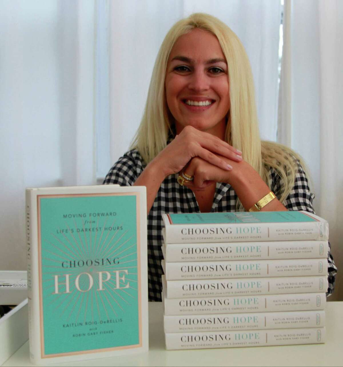 """Kaitlin Roig-DeBellis, a former educator at Sandy Hook Elementary School, at her home in Greenwich on Wednesday. The Sandy Hook teacher wrote a book about surviving the December 2012 tragedy called """"Choosing Hope: Moving Forward from Life's Darkest Hours."""""""