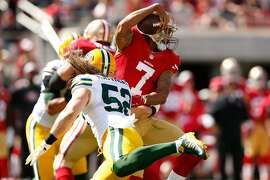 SANTA CLARA, CA - OCTOBER 04:  Inside linebacker Clay Matthews #52 of the Green Bay Packers hits quarterback Colin Kaepernick #7 of the San Francisco 49ers during their NFL game at Levi's Stadium on October 4, 2015 in Santa Clara, California.  (Photo by Ezra Shaw/Getty Images)