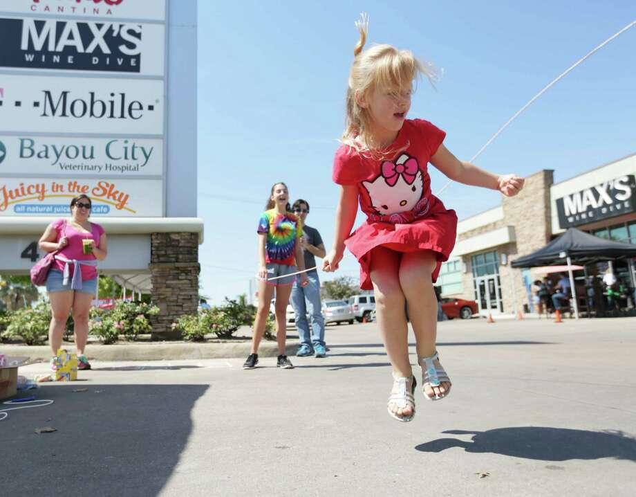 A girl jumps rope at the Sunday Streets event on Washington Avenue. Photo: Jon Shapley, Houston Chronicle / © 2015  Houston Chronicle