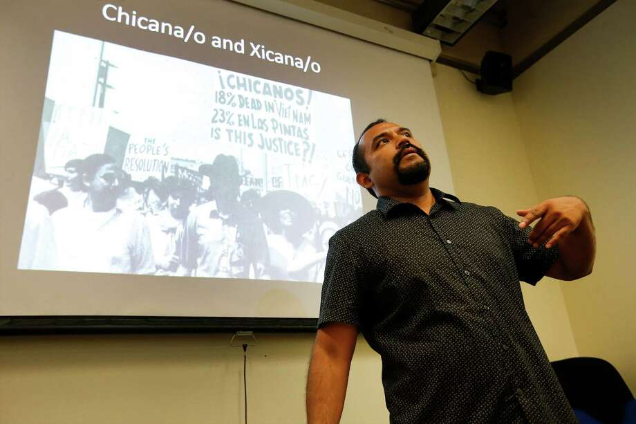 UTSA professor Marco Cervantes teaches the class, Mexican Americans in the Southwest, at the university's main campus on Thursday, Aug. 28, 2015. Cervantes also uses his ability to rap to teach culture and customs in his Mexican Studies course. (Kin Man Hui/San Antonio Express-News) Photo: Kin Man Hui, Staff / San Antonio Express-News / ©2015 San Antonio Express-News