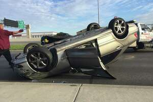 Collision on Loop 410 causes car to rollover, sends another into the gates of a restaurant - Photo