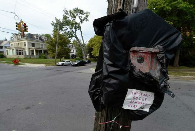 A black plastic bag covers an out of service fire department call box on the corner of Union Street and Wendell Avenue Monday morning Sept. 28, 2015 in Schenectady, N.Y.    (Skip Dickstein/Times Union) Photo: SKIP DICKSTEIN / 00033525A