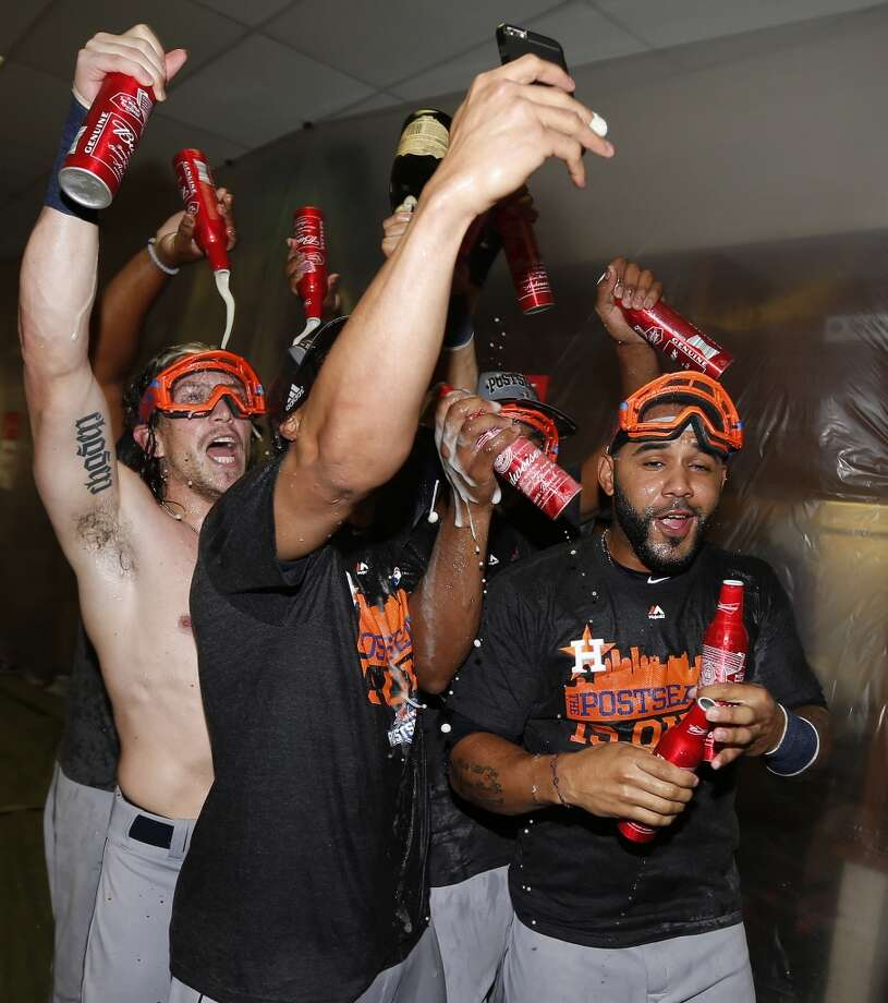 Houston Astros Colby Rasmus, Carlos Gomez, Jonathan Villar and others celebrate in the locker room after the Astros clinched an American League wild card berth after their game at Chase Field on Sunday, Oct. 4, 2015. ( Karen Warren / Houston Chronicle ) Photo: Karen Warren, Houston Chronicle