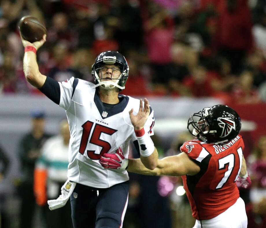 Texans QB Ryan Mallett is harassed by Falcons linebacker Kroy Biermann on Sunday. An inefficient Mallett was pulled for Brian Hoyer in the third quarter. Photo: Brett Coomer, Staff / © 2015  Houston Chronicle