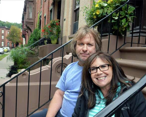 Home owners Keith and Michele Kansu on the stoop of their Washington Place house Friday, Oct. 2, 2015, in Troy, NY.  (John Carl D'Annibale / Times Union) Photo: John Carl D'Annibale / 10033551A