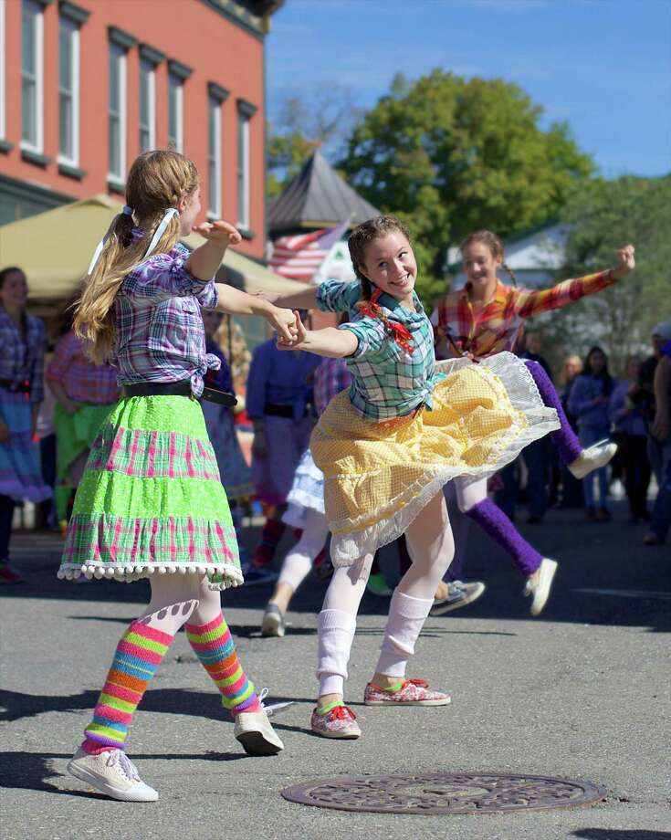 The Greater New Milford Chamber of Commerce hosted the seventh annual Harvest Festival on Sunday, October 4th, 2015, in downtown New Milford. Dancers from AIM (Artists in Motion), in residence at Fineline, took on Bank Street to entertain the crowd.  Here, Kiah Liotta and Elena Harcken pair up during a fun hoedown dance on Bank Street. Photo: Trish Haldin / For Hearst Connecticut Media / The News-Times Freelance