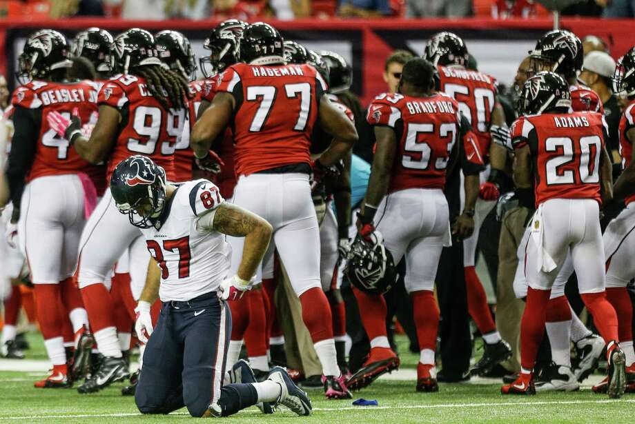 Texans tight end C.J. Fiedorowicz (87) tries to recover after the Falcons, already leading 28-0, picked up his second-quarter fumble. Photo: Brett Coomer, Staff / © 2015  Houston Chronicle