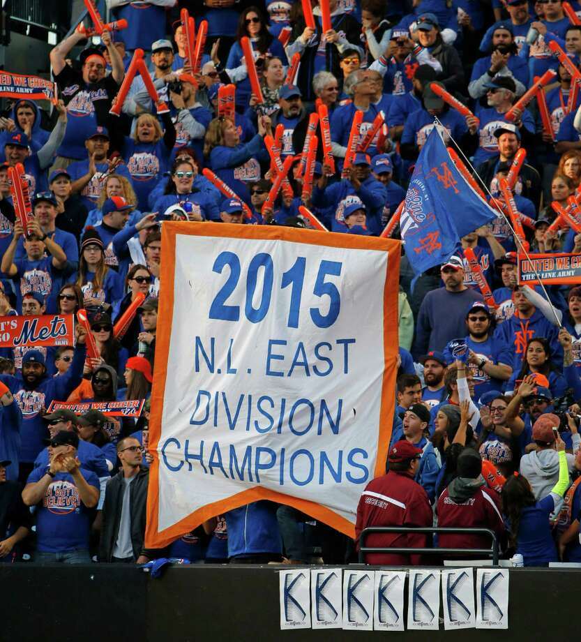 New York Mets fans celebrate the Mets season with a banner in center field after the Mets concluded the regular season with a 1-0 shutout of the Washington Nationals in a baseball game in New York, Sunday, Oct. 4, 2015. (AP Photo/Kathy Willens) ORG XMIT: NYM125 Photo: Kathy Willens / AP