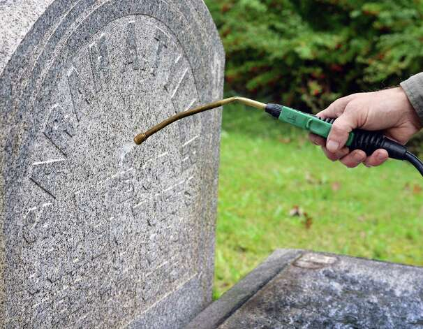 Joe Ferranninie, owner of Grave Stone Matters of Hoosick Falls, cleans the granite grave stone of Sarah Tyler from 1875 in Albany Rural Cemetery Thursday Oct. 1, 2015 in Menands, NY.  (John Carl D'Annibale / Times Union) Photo: John Carl D'Annibale / 10033566A