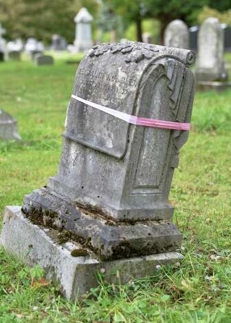 The now unsafe marble grave stone of Benjamin Miles from 1864 awaits resetting in Albany Rural Cemetery Thursday Oct. 1, 2015 in Menands, NY.  (John Carl D'Annibale / Times Union) Photo: John Carl D'Annibale / 10033566A