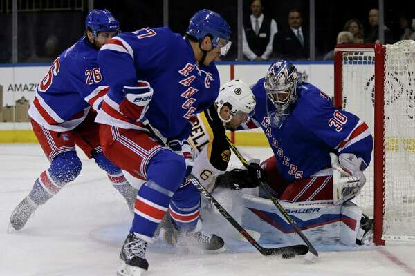 New York Rangers goalie Henrik Lundqvist (30) makes a save on a shot by Boston Bruins right wing Tyler Randell (64) as Rangers defenseman Ryan McDonagh (27) looks on during the first period of an NHL preseason hockey game at Madison Square Garden in New York, Wednesday, Sept. 30, 2015. (AP Photo/Adam Hunger) ORG XMIT: MSG102