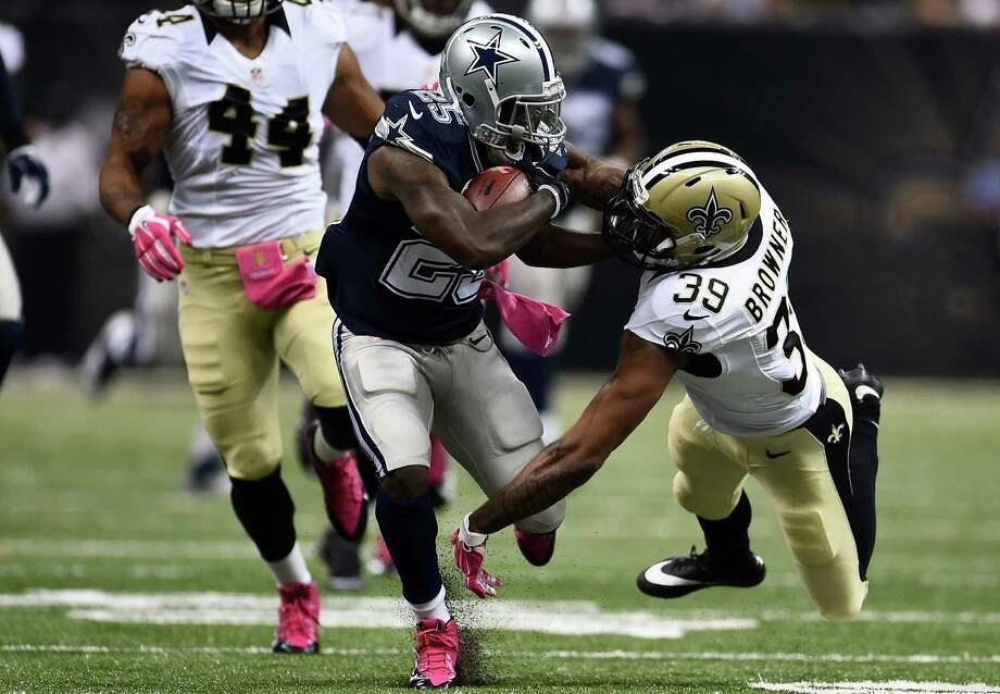NEW ORLEANS, LA - OCTOBER 04:  Lance Dunbar #25 of the Dallas Cowboys defends  Brandon Browner #39 of the New Orleans Saints during the first quarter against the Dallas Cowboys at Mercedes-Benz Superdome on October 4, 2015 in New Orleans, Louisiana.  (Photo by Stacy Revere/Getty Images) Photo: Stacy Revere, Stringer / 2015 Getty Images