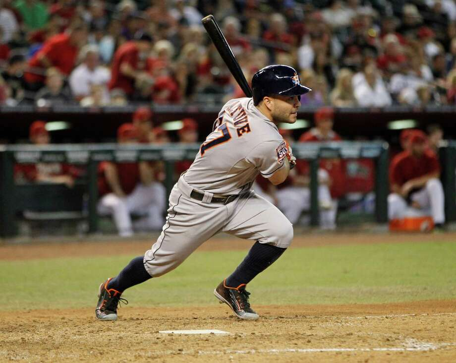 Astros second baseman Jose Altuve strokes a single to right in the ninth inning for his third hit of the day and 200th of the season. He owns two of the three 200-hit seasons in franchise history, with Craig Biggio producing the other. Photo: Karen Warren, Staff / © 2015 Houston Chronicle
