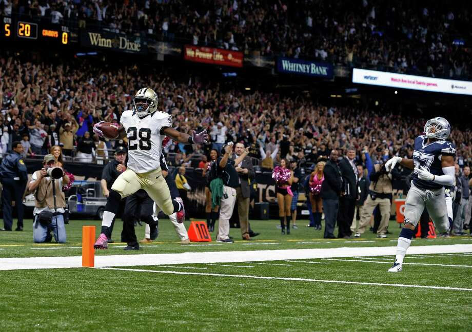 New Orleans Saints running back C.J. Spiller (28) scores the game-winning touchdown during overtime of an NFL football game against the Dallas Cowboys in New Orleans, Sunday, Oct. 4, 2015. The Saints won 26-20. (AP Photo/Jonathan Bachman) Photo: Jonathan Bachman, FRE / Associated Press / FR170615 AP