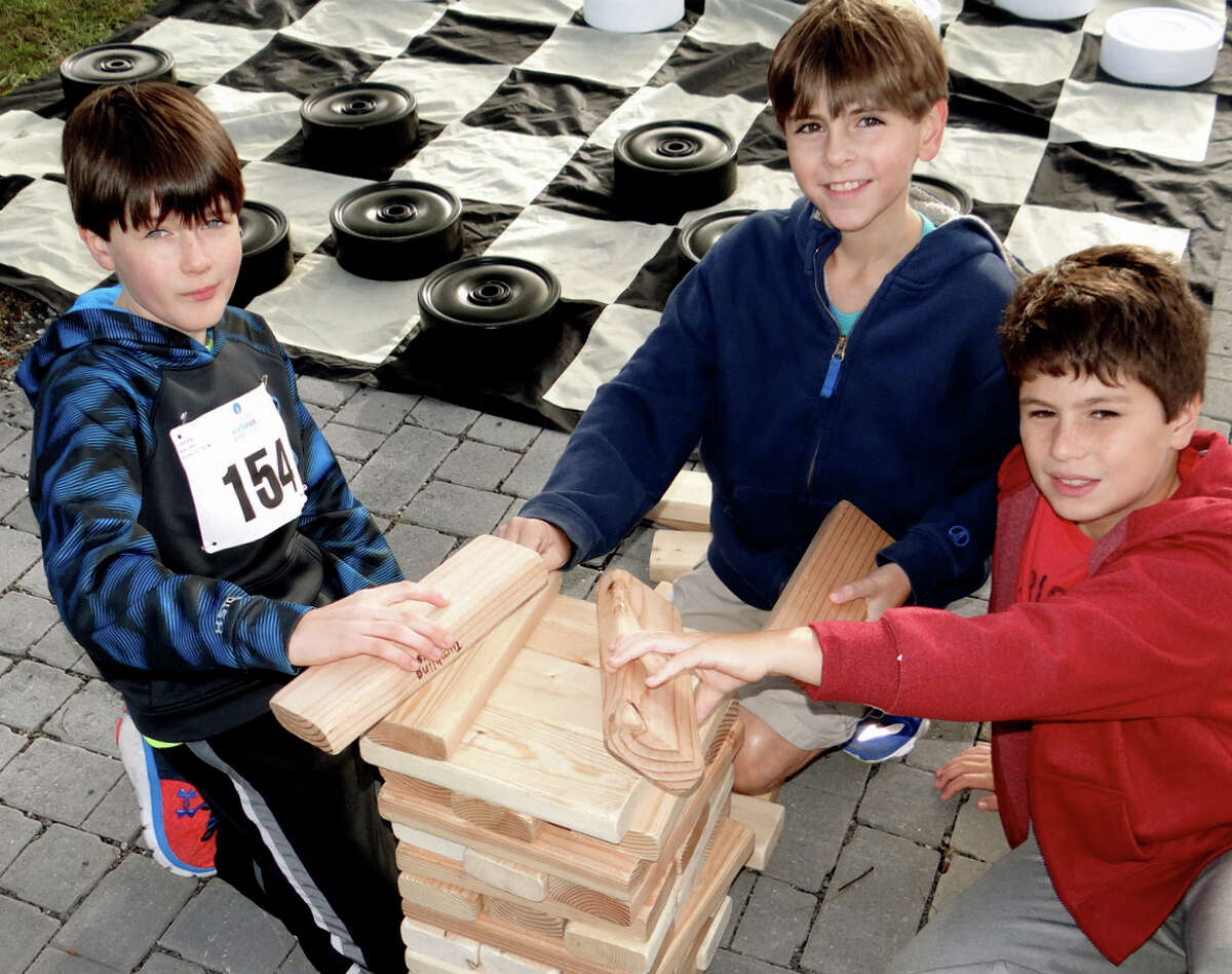 Fairfielders John Kuhl, Rory Tamulis and Ewan Dignon, all 10, play a game of Jenga at CancerCare's Walk/Run for Hope on Sunday at Jennings Beach.