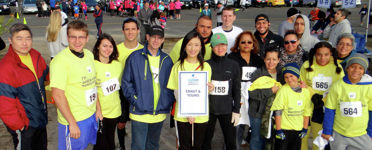 Karen Wang, center with sign, and her team of fellow employees from Ernst & Young of Stamford ready to join CancerCare's Walk/Run for Hope at Jennings Beach.