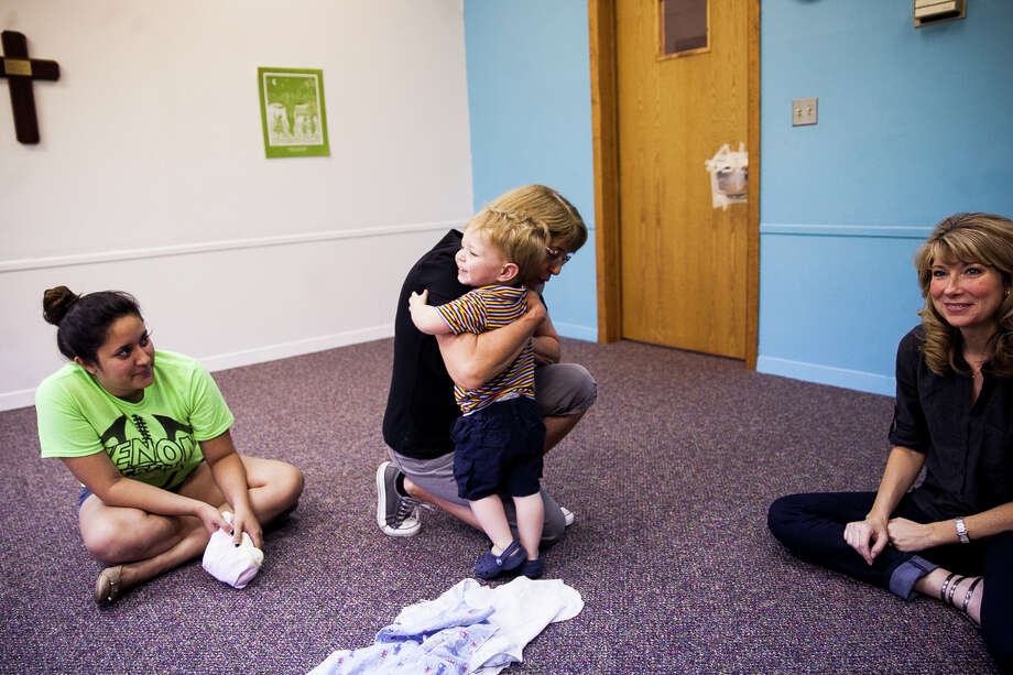 Bryce Bennett, 2, hugs music teacher Patsy Lawry, at the end of their Music Together class Thursday Oct. 1, 2015 in the Children's Church classroom at Northwood Presbyterian Church. Lawry is a certified teacher and has been teaching with the program for the past 18 years. Photo: Julysa Sosa /For The Express-News / Julysa Sosa For the San Antonio Express-News
