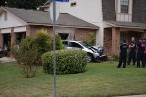 Police: Car crashes into home during road rage incident - Photo