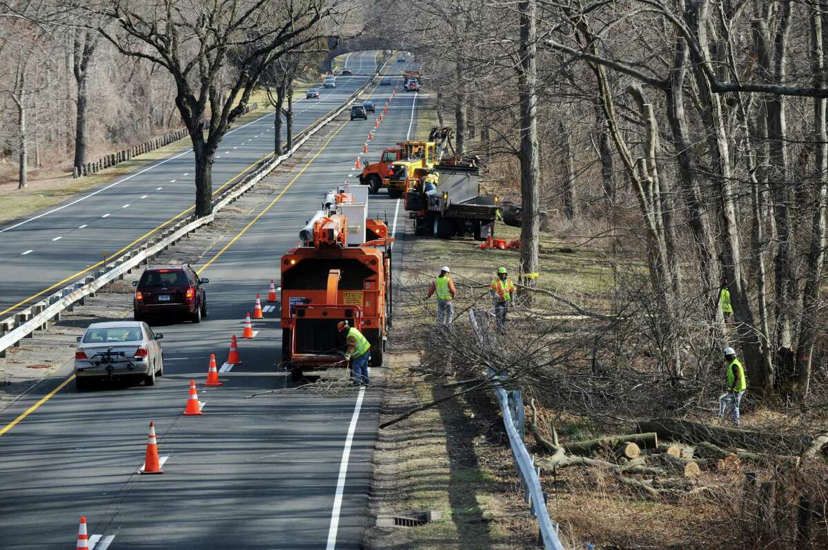 State Department of Transportation workers trim trees along the Merritt Parkway in Fairfield.