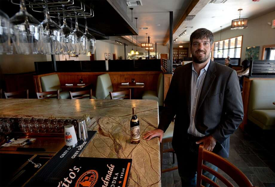 John Wilson, owner of J Wilson's in Beaumont stands near the restaurant's bar.  