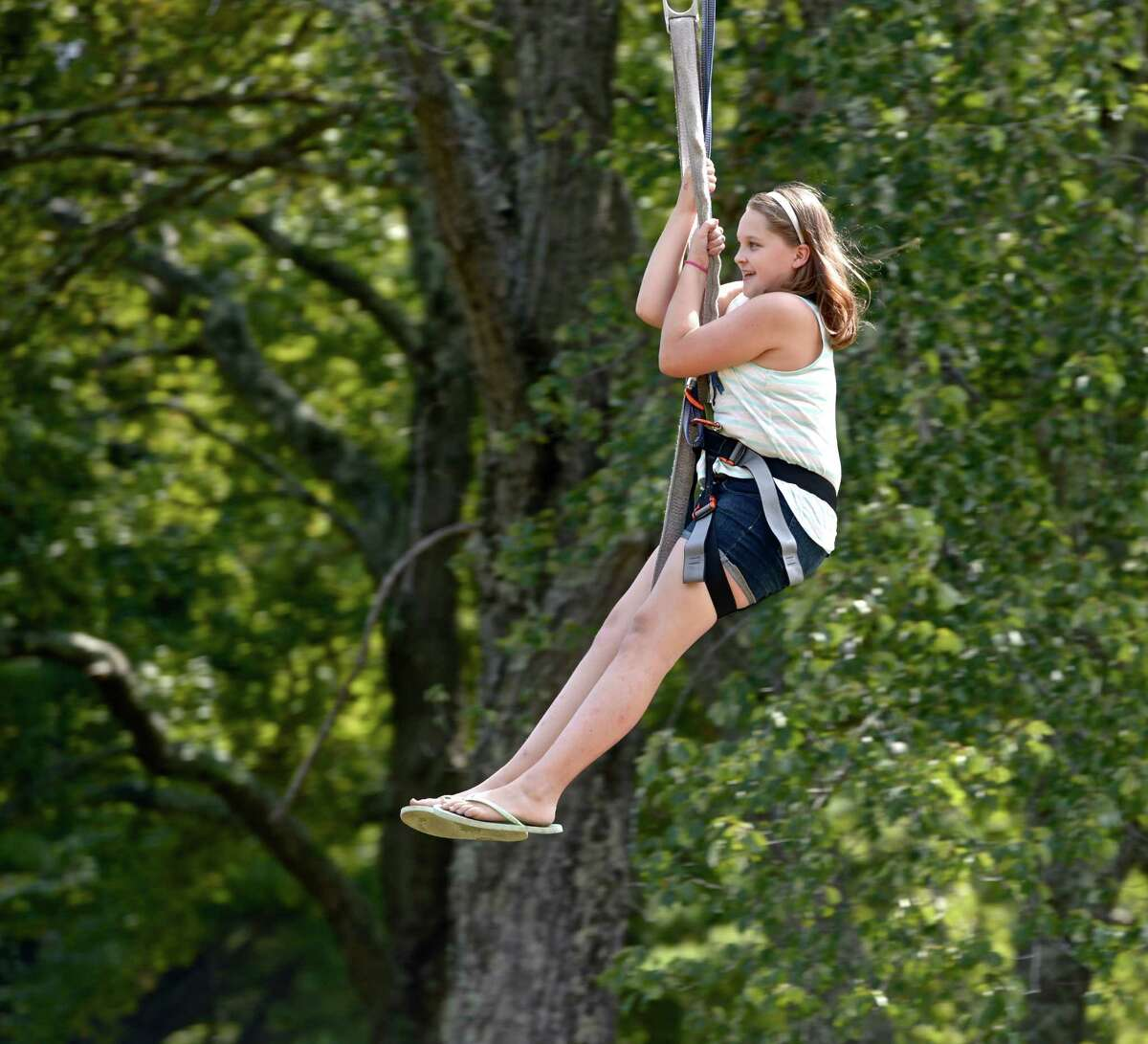 Madison Hayden, 10, of New Milford, takes a ride on a zip line at Harrybrooke Park, in New Milford. A new study shows that zip line injuries rose about 50 percent between 2009 and 2012.