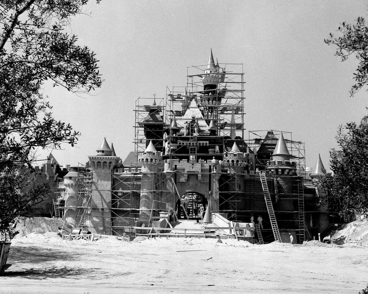 """HOW DISNEYLAND USED TO LOOK: Two months before she """"awoke"""" to opening day visitors in 1955, Sleeping Beauty's Castle, a Disneyland landmark, was getting a few final touches from construction workers. Walt Disney wanted this castle to be a friendly and welcoming presence in his park so it was built on a smaller scale than its European counterparts."""