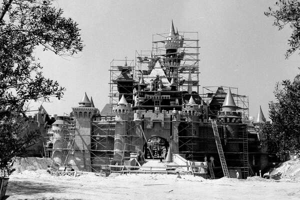 "Two months before she ""awoke"" to opening day visitors in 1955, Sleeping Beauty's Castle, a Disneyland landmark, was getting a few final touches from construction workers.  Walt Disney wanted this castle to be a friendly and welcoming presence in his park so it was built on a smaller scale than its European counterparts."