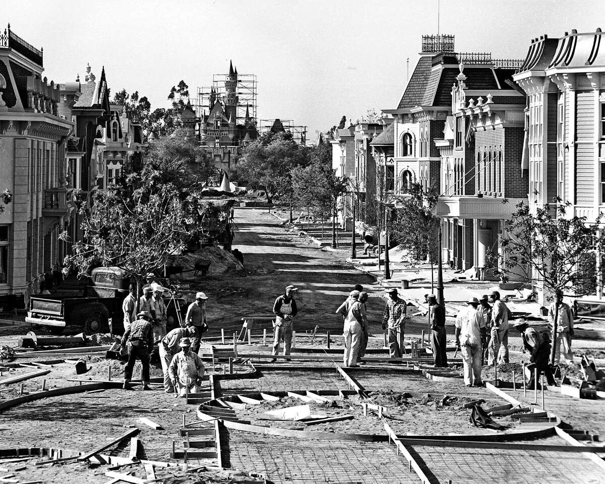1955: Disneyland workers prepare to pour cement where the northern edge of Town Square meets Main Street USA.