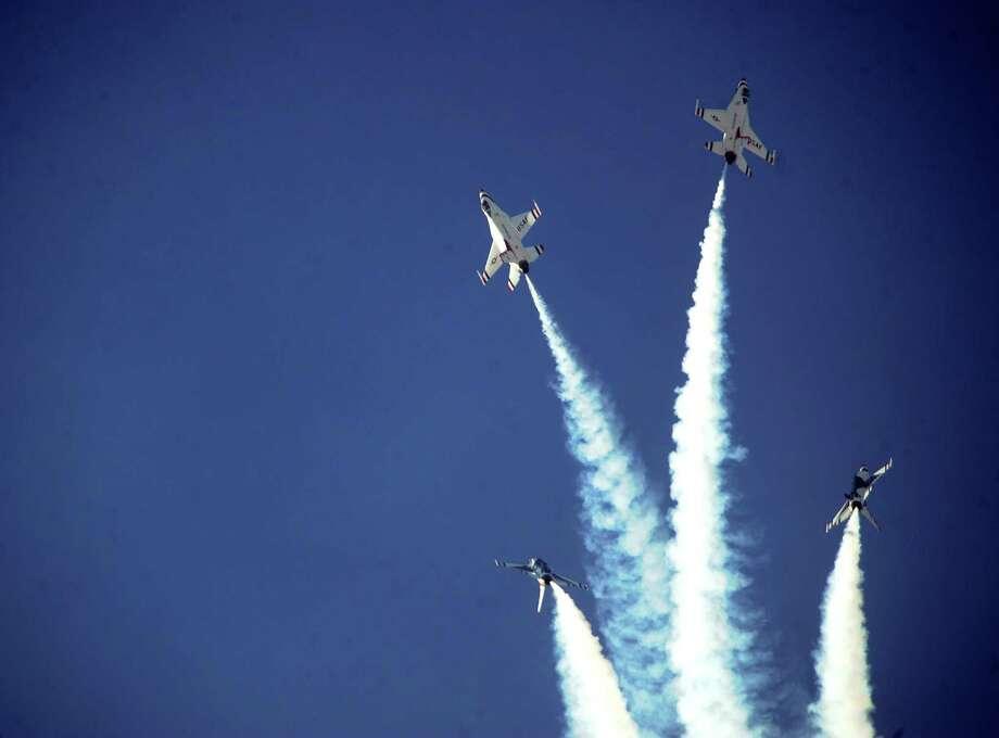 The Thunderbirds perform their signature bomb-burst maneuver during AirFest 2010 at Lackland Air Force Base on Saturday, Nov. 6, 2010. BILLY CALZADA / gcalzada@express-news.net Photo: BILLY CALZADA, STAFF / SAN ANTONIO EXPRESS-NEWS / gcalzada@express-news.net