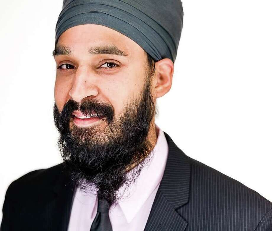 Simran Jeet Singh sat in the front row at the interfaith service. His wife was onstage. Photo: Courtesy Photo /Courtesy Photo