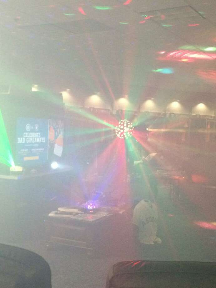 """The Astros added a fog machine and lights to their clubhouse to create """"Club Astros"""" as a way to celebrate this season."""