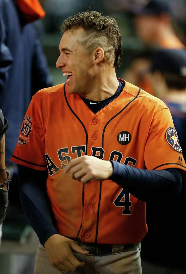 Ask your barber for the SpringerIt's time to get nuts. No matter what happened Monday, the Astros are one win away from advancing to the ALCS. This is no time to get tentative. Go all out and visit your local barber and demand he give you George Springer's haircut. It's kind of a mohawk. It's kind of a fade. Whatever it is, make sure it involves a squiggly line shaved down the side of your head. The squiggly line is key. Photo: Karen Warren, Staff / © 2015 Houston Chronicle