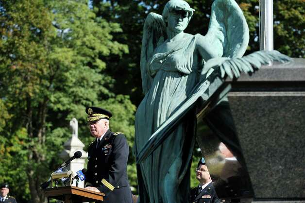 Brigadier General Michael Swezey, background, commander of the 53rd Troop Command of the New York Army National Guard, talks about President Chester Arthur during a presidential wreath laying ceremony at the gravesite of President Arthur on Monday, Oct, 5, 2015, at the Albany Rural Cemetery in Menands, N.Y.  The event was held to honor President Arthur on his birthday.  (Paul Buckowski / Times Union) Photo: PAUL BUCKOWSKI / 10033591A