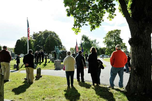 Visitors gather for a presidential wreath laying ceremony at the gravesite of President Chester Arthur on Monday, Oct, 5, 2015, at the Albany Rural Cemetery in Menands, N.Y.  The event was held to honor President Arthur on his birthday.  (Paul Buckowski / Times Union) Photo: PAUL BUCKOWSKI / 10033591A