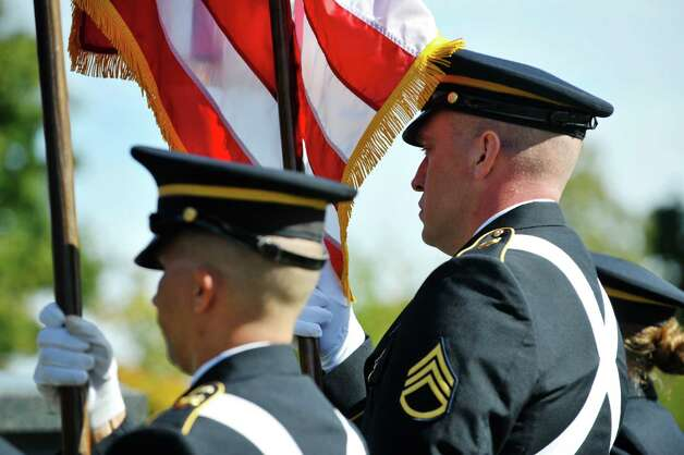 Members of the color guard of the 53rd troop command of the New York Army National Guard from the Division of Military and Naval Affairs in Latham take part in a presidential wreath laying ceremony at the gravesite of President Chester Arthur on Monday, Oct, 5, 2015, at the Albany Rural Cemetery in Menands, N.Y.  The event was held to honor President Arthur on his birthday.  (Paul Buckowski / Times Union) Photo: PAUL BUCKOWSKI / 10033591A