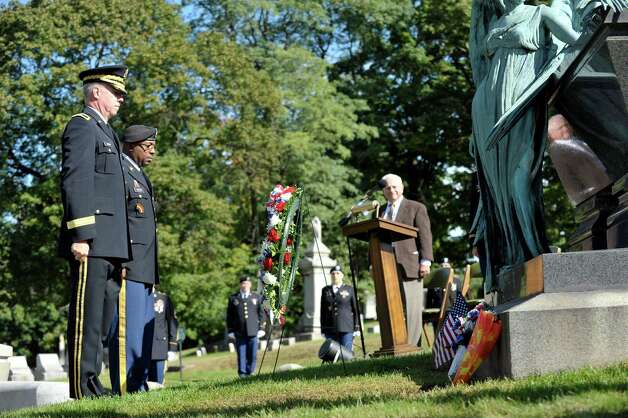 Brigadier General Michael Swezey, left, commander of the 53rd Troop Command of the New York Army National Guard and State Command Sergeant Major Louis Wilson, second from left, stand at the gravesite of President Chester Arthur after placing a wreath from President Obama during a ceremony on Monday, Oct, 5, 2015, at the Albany Rural Cemetery in Menands, N.Y.  The event was held to honor President Arthur on his birthday.  (Paul Buckowski / Times Union) Photo: PAUL BUCKOWSKI / 10033591A