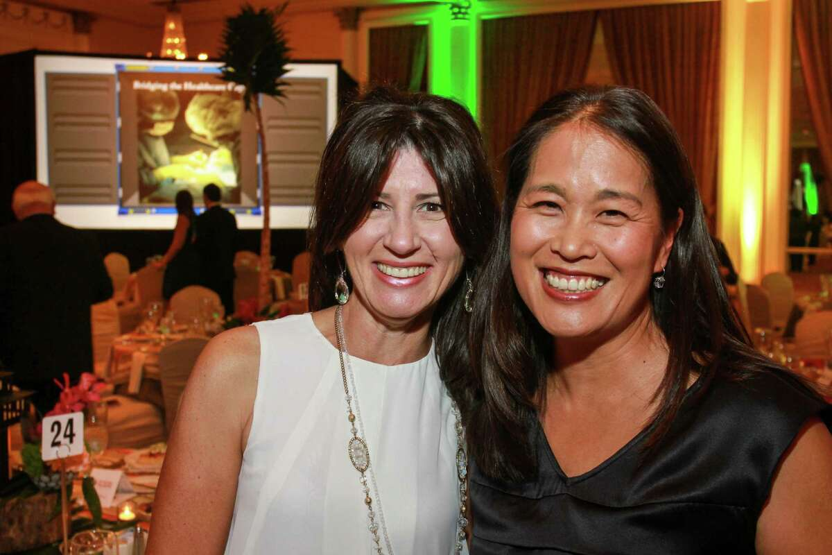 Teresa Davis, left, and Grace Kim at the Medical Bridges gala. (For the Chronicle/Gary Fountain, October 3, 2015)