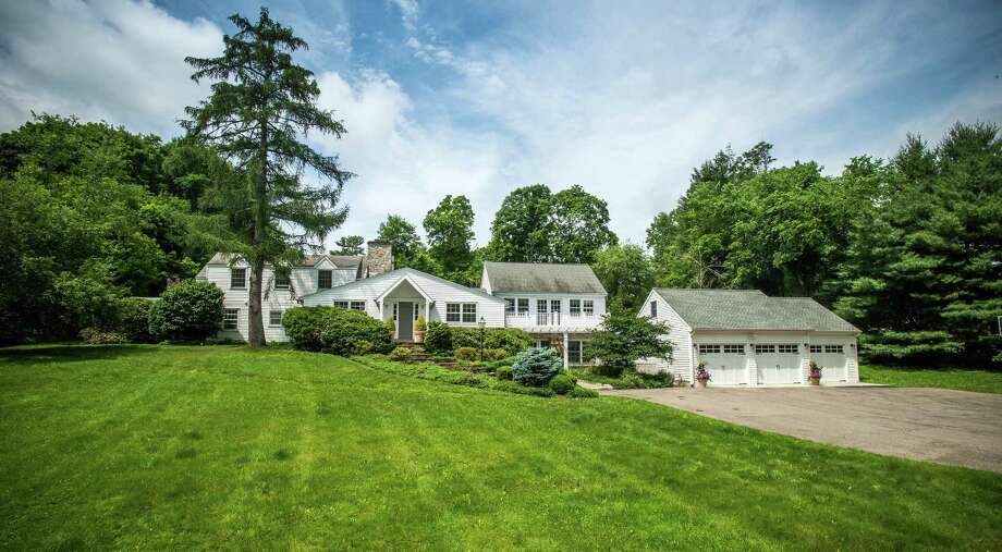 This home on New Canaan's Hickory Drive has 5,000 square feet of living space, with four bedrooms and three family rooms. Photo: Contributed / Contributed Photo / © SR Photo, LLC All Rights Reserved