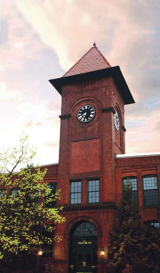 Nine units at Clocktower Close in Norwalk, a former hat factory that was converted to residential condominiums are coming up for auction on Saturday, April 17. Four of the studio and one-bedroom condos offered will be sold subject to low minimum bids of $99,000 to $150,000, according to auctioneer, Sheldon Good & Company. The two-bedroom unit has a reserve price. Viewing takes place March 21, 27 and 28 and April 3, 10 and 11.  Head shot of Teresa Hatton, the new executive vice president of the Greenwich Association of Realtors and the Greenwich Multiple Listing Service. Hatton was most recently executive director and executive vice president of the 1,500-member Williamson County Association of Realtors in Tennessee. Photo: Contributed Photo / Stamford Advocate Contributed