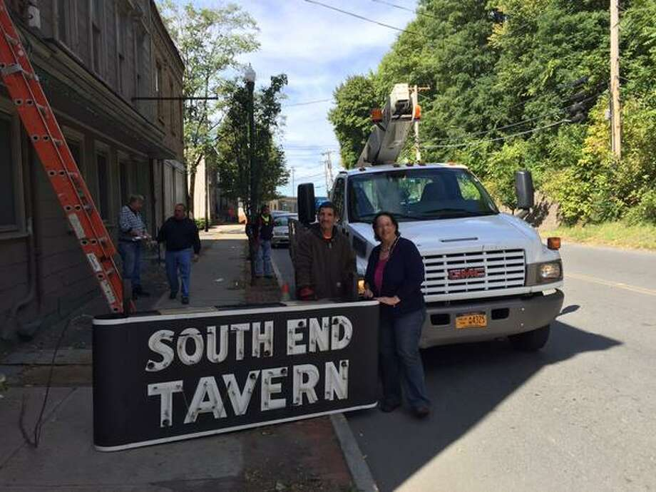 The Rensselaer County Historical Society wants to buy the signs from the now defunct South End Tavern in South Troy. (Kenneth C. Crowe II / Times Union)