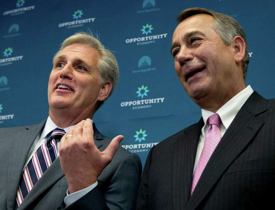 House Majority Leader Kevin McCarthy of Calif. gestures toward outgoing House Speaker John Boehner of Ohio during a new conference on Capitol Hill last week. McCarthy is assuring Republicans he can bring them together, even as emboldened conservatives maneuver to yank their party to the right in the wake of Boehner's sudden resignation. Photo: Carolyn Kaster /Associated Press / AP